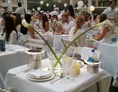 Last night, about 3,200 people decked out in elaborate, all-white ensembles showed up unannounced at New York City's Lincoln Center, set up tables, and started eating as part of the annual Diner en Blanc…