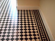 LOVE THIS!  Floor in kitchen.  Could do in vinyl or tile.  The edging is a must!