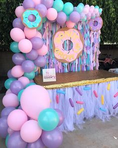 Donut 🍩 Grow Up candy table setup. Desserts provided by customer Sprinkles Tutu Table skirt #pinktulipcreations #sprinkletutu #goldsequin…