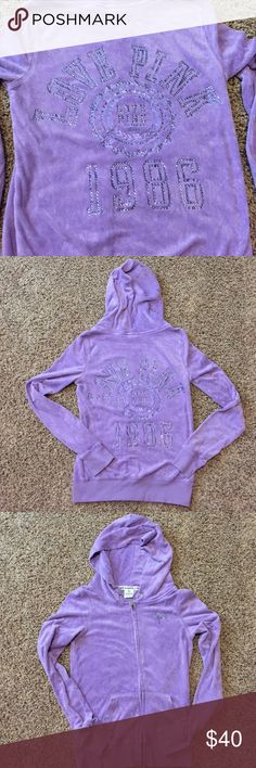 PINK bling french terry zip up hoodie. Purple french terry bling (stones not sequin) zip up hoodie like new. Bling dog on front and bling LOVE PINK 1986 with bling crest in center back. PINK Victoria's Secret Tops Sweatshirts & Hoodies