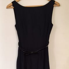 """kate spade Sonja Dress This elegant number by kate spade will make any occasion lovelier! Fitted at the waist, with a black patent bow belt; hits at the knee (for reference, I'm 5'4""""); a-line skirt; scoop back. The navy material is 98% cotton, 2% elastane. This dress has been loved, but VERY well taken care of, so it only shows minimal signs of wear - but nothing specifically noticeable. Look for the silver lining! kate spade Dresses"""
