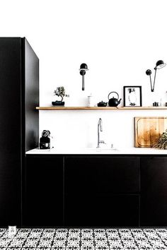 All black kitchen with wooden details