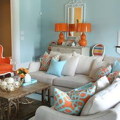 DecorPad.com Colordrunk Design - living rooms - Valspar - La Fonda Mirage - blue and orange living room, orange gourd lamp, orange lamp with orange shade, gray chest, stairs in living room, stairway in living room, white faux bamboo mirror, white chinoiserie mirror, linen sectional sofa, linen sectional, aqua blue pillow