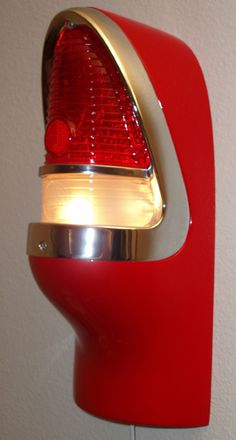 55 Chevy wall sconce. Hand-laid fiberglass reproduction of the actual product sprayed with two stage automotive paint. Uses 40w to 75w light bulb.