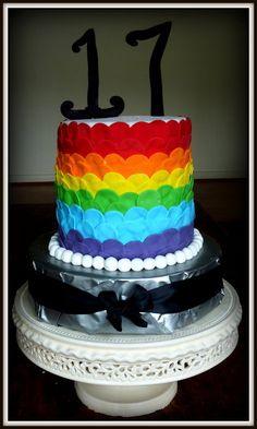 Rainbow cake...or fondant rainbow circles onto cake.... ask Aya which she prefers