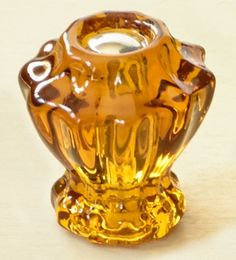 Antique-inspired amber warms up this traditional ridged-shape Small Fluted Glass Cabinet Knob from House of Antique Hardware; $4.39