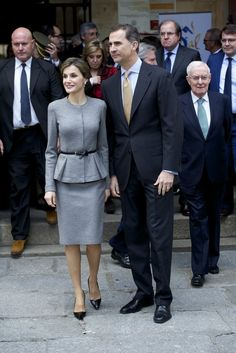 Queen Letizia looked demure and sleek in a fitted grey suit in Salamanca, Spain.