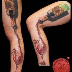 Anyone want wine? Tattoo by Shame Acuff. #Inked #inkedmag #tattoo #wine #drink #Leg #creative #sleeve #idea