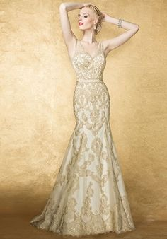 This classic fit and flare, substainable lace gown features plunging neckline and sheer lace back with covered buttons elegant, hand beaded detail highlights the natural wasitline.