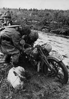 Karelia Russia. SS Nazi motorcycle crew struggle in the notorious Russian mud