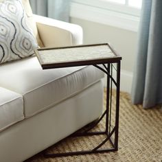 Reimagine the TV tray with Kirkland's Chocolate and Cream Geometric C-Table! It's the perfect table to pull up to the couch to eat dinner or snack on popcorn while you watch a movie. This is a must-have for every modern media room!