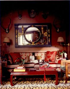 Alex Papachristidis ~ #red sitting space - cozy and elegant - love the #tiger rug