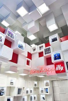 La diseñadora italiana Caterina Tiazzoldi ha creado esta preciosa tienda temporal para Illy Caffe, en Milán, en la Galería San Carlo.