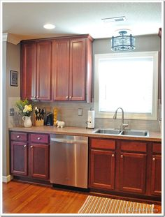 """Paint color with those cherry cabs is what I'm looking for.  It's a dupe of Serena and Lily's paint in """"Mushroom"""" done in SW custom match.  I also pinned the picture of the code for this color.  This may be the one for our kitchen."""