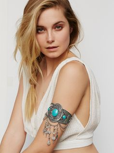 Stretch Upper Arm Band   Metal armband with a stretch back. Each color features different glass and semiprecious stone charms and accents.