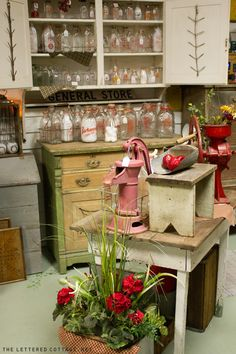 This whole place is filled with cottage finds! Love the yellow and green dresser w/ the milk bottles on it!