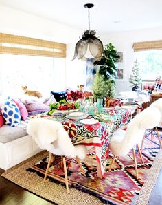 Love the idea of having sheepskin rugs draped over dining room chairs! Adds a bit of glamour