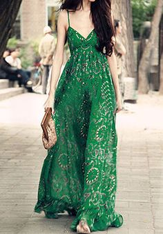 Model in green printed maxi dress walking in the streets