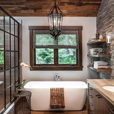 Inside a Stylish Mountain Home on Lake Tahoe Designed by Jeff Andrews - A vintage light from Paris hangs above the tub in the master bathroom, which is accented by a side - Douche Design, Beautiful Bathrooms, Dream Bathrooms, Log Homes, House Plans, Glass Shower, Shower Door, Shower Bathroom, Master Shower