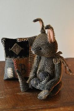 A bunny with crazy quilt pillow by Lori Ann Corelis. I love her bunnies and other critters, and I love crazy quilts and embroidery.