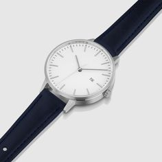 The navy watch strap on the Minimalist by Linjer is made from full-grain Italian leather coloured with natural plant pigments including chestnut, quebracho and mimosa. Dezeen Watch Store, Italian Leather, Norway, Leather Bag, Fashion Accessories, Objects, Product Launch, Minimalist