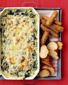 Mozzarella and cream cheese make this hot spinach dip extra-rich. To save time, you may use frozen spinach in place of fresh. This appetizer can be made up to three days ahead of time and baked shortly before you are ready to serve it.