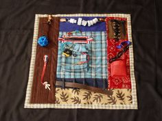 A Fidget Quilt can be used by Alzheimers, Dementia or Brain Trauma Patients. It has attachments to keep restless fingers busy, touching and