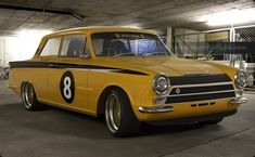 Yellow Lotus Cortina in racing spec with spoiler and GP5 Alloys