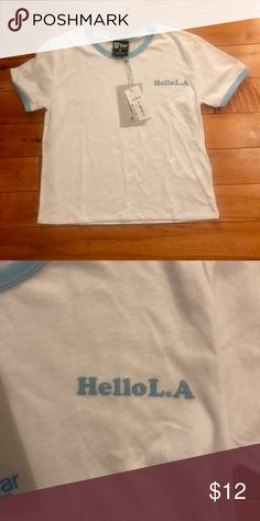 NWT cotton on crop top Nwt tags cotton on crop t shirt!! That's says hello L.A ! Super comfy!! It's a small but I think it could fit a medium also!! I bought two of these shirts Cotton On Tops Crop Tops