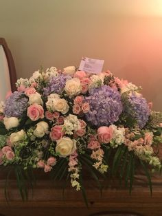 Soft blues & light pinks casket spray by Donna Jeffries