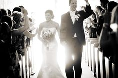 Paul and Kelly's Queen of the Snows Catholic Church Squaw Valley Lake Tahoe Wedding exit - backlit with sun flare