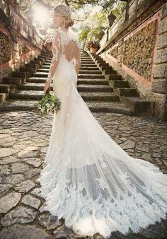 Style D1950 from Essence of Australia |  Lace over Matte-side Lustre Satin sheath bridal gown, stunning keyhole back and sleeves of illusion lace, elegant panel train, and a back zipper closure hidden under fabric-covered buttons. | https://www.theknot.com/fashion/d1950-essense-of-australia-wedding-dress