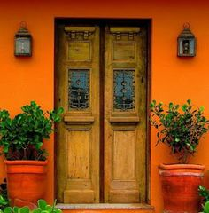 orange walls offset these amazing doors, the whole entrance is a delight for the eyes Cool Doors, The Doors, Unique Doors, Windows And Doors, Front Doors, Door Knockers, Door Knobs, Murs Oranges, When One Door Closes