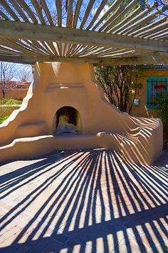 outdoor kiva fireplace and branch canopy in Santa Fe, New Mexico New Mexico Style, New Mexico Homes, Mexico House, Southwestern Home, Southwest Style, Southwest Decor, Porches, Santa Fe Home, Spanish Style Homes