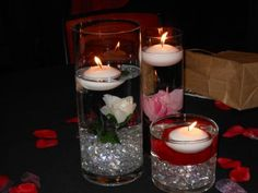 Michaels floating candle centerpiece idea. Mirror underneath, LED light in the bottom of the vase