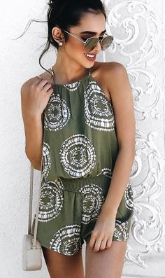 dc92b0b51166 A woven cami romper featuring an allover tie-dye wash in a geo pattern