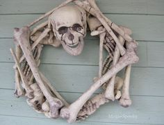 DIY Halloween wreath.The real tutorial on how to make this bone wreath.  Ready, Set, Craft!: Guest Post: Skeleton Wreath