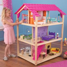 Our So Chic Dollhouse can be played from all four open sides and features an extraordinary amount of detail that any little girl will love. This dollhouse includes fifty colorful pieces of furniture for never-ending play.