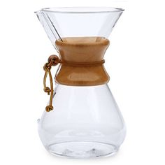 Chemex Glass Coffeemaker - The Chemex coffeemaker is known for its iconic design. Its hourglass shaped flask is made entirely of borosilicate glass, a chemically inert material that does not absorb odors or chemical residues. Includes a polished wood collar with a leather tie that serves as a handle.   •Recommend hand washing  •Can also be used to brew tea  •Made in the US