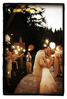 I think I will be investing in some sparklers for my wedding just to get a picture as cute as this one! :D