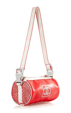 e37b2ae7932e This vintage   Chanel   sportline bag from   What Goes Around Comes  Around   features a polyester body in red with ...