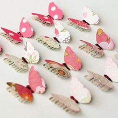 from etsy.... butterfly punch idea ..used old dictionary pages, colored glittered paper, and/or cardstock to give these butterflies 2 layers of charm. The bit of glitter in the center gives it just enough sparkle to dress it up to make it an eye-catching embellishment