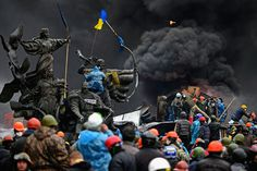 Anti-government protesters continue to clash with police in Independence square [Maidan Nezalezhnosti], despite a truce agreed between the Ukrainian president and opposition leaders on February 20, 2014 in Kiev. (Jeff J Mitchell/Getty Images)  The statue in the center of the square depicts the brothers Kyi, Shchek, & Khoryv and their sister Lybid, the founders of Kiev (according to legend).