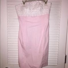 Lilly Pulitzer Size 2 Franco Pink Gingham Sundress Lilly Pulitzer Size 2 Franco Dress Pink Gingham with White Lace Sundress --> NO TRADES   Amazing pink gingham contrasts with an intricate white lace bust. The back of this dress is the best since you can tie an amazing little bow or knot. Excellent pre-owned condition (worn twice). Strapless with a zipper and tie in the back.   - Pink and white gingham - White lace, strapless and an adorable back - Fully lined in white - 100% Cotton Lilly…