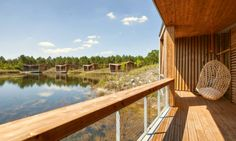 Eco-lodges les Echasses comprises a series of timber huts built on stilts in Southwestern France.