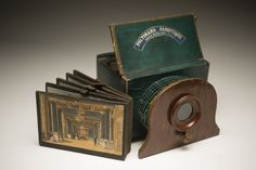 The Polyorama Panoptique, a 19th century optical device, a small-scale version of the diorama, simplified for home use. It is of a portable box-camera for viewing printed and painted cards with a viewing lens attached to a concertina device for adjustment. The card is inserted at the back of the box, which held up to the light, so that various effects are produced by illuminating the different textures and cut out parts of the card.