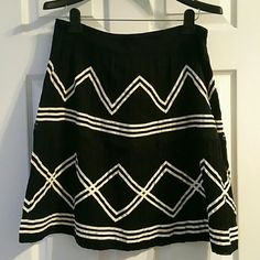 ANTHROPOLOGY FLOREAT BLACK&OFF WHITE ZIG ZAG SKIRT ANTHROPOLOGY, FLOREAT, BLACK & OFF WHITE ZIG ZAG LINES & STRAIGHT LINES 1 LINE OF BLACK LACE SIDE ZIPPER.  SIZE 10  MAIN 80% COTTON 20% NYLON LINING 100% COTTON NWT NEW WITH TAG From A Local Boutique!   No Smoking, Buy It Now, Questions Are Welcome, Make A Reasonable Offer, Bundle Discounts, Posh Only, NO TRADES!! Anthropologie Skirts Midi