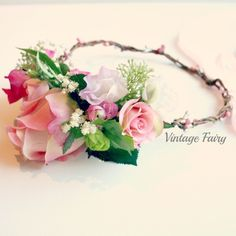 Welcome to Vintage Fairy This crown is stunning, made from amazing quality silk flowers, rose buds, sweet peas, ranunculus, filler flowers and leaves. The flowers cluster to the side of the crown. Gorgeous silver and pink berries twist around the crown.Perfect for any ageFlowergirls, brides, bridesmaids,weddings, christenings,church, parties,celebrations, fairy crown, photoshoot, photographers, photo props, headpiece, halo, flower wreath, prop vendor