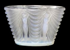 Property from a Palm Beach Collection RENE LALIQUE 'TERPSICHORE' A rare and very fine opalescent glass vase, model introduced 1937 Marcilhac 10-911   8.25in. (20.62 cm) high acid stamped R. Lalique