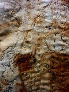 Rust on fabric., texture created by creases and bunching of fabric while stitching